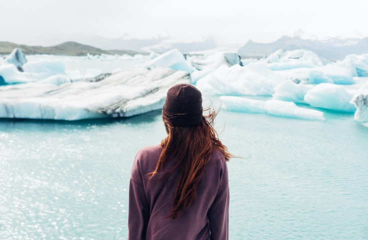 Woman looking at icebergs